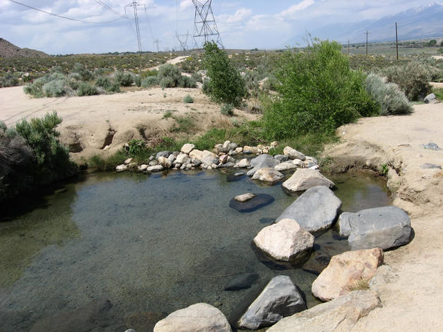 Another pool with power lines and road in background (Keough Hot Ditch)