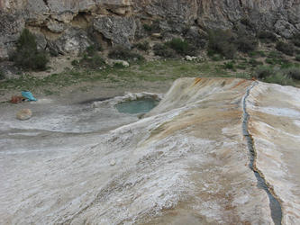 water flowing on top of ridge to pools (travertine)