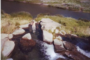 Andy soak's atop the water fall(Three Forks)